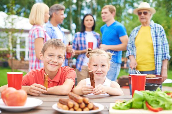 Groot familie kinderen eten worstjes Stockfoto © pressmaster