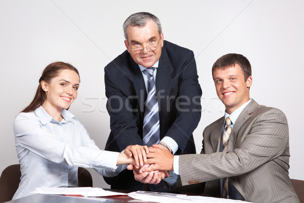 Union partenaires photo trois mains haut Photo stock © pressmaster