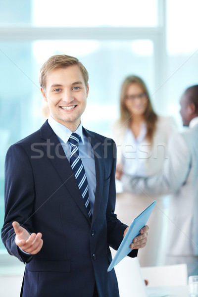 Jefe touchpad retrato alegre mirando cámara Foto stock © pressmaster