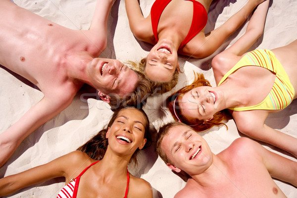 Сток-фото: фото · улыбаясь · люди · круга · песок