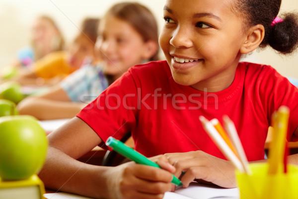 Atenção alunos olhando professor bonitinho Foto stock © pressmaster