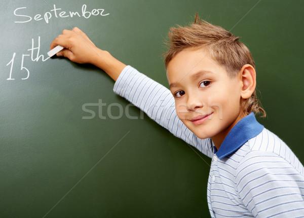 Stock photo: Boy at blackboard