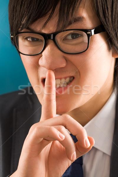 Gebaar portret jonge zakenman vinger mond Stockfoto © pressmaster