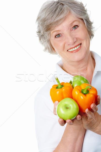 Yaşlı kadın portre elma Stok fotoğraf © pressmaster