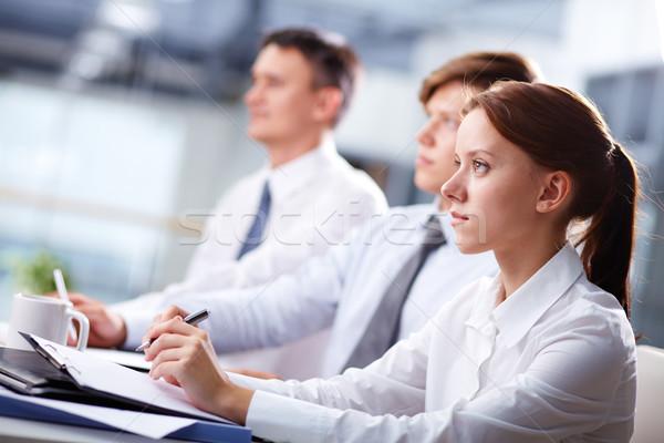 Attentif rangée gens d'affaires séminaire écouter homme Photo stock © pressmaster
