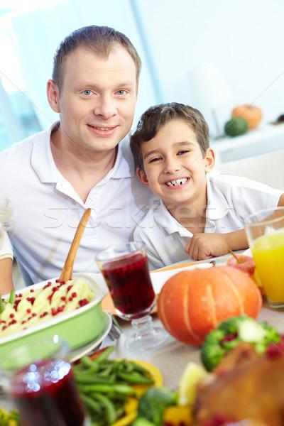 Boldog lakoma portré vidám fiú apa ül Stock fotó © pressmaster