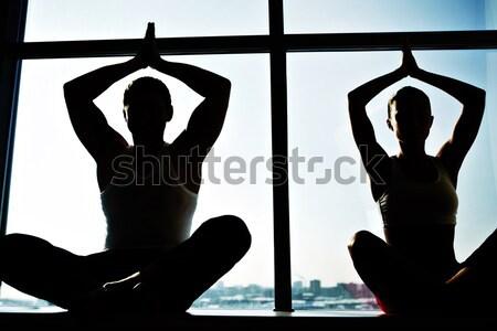 Stock fotó: Jóga · fotó · meditál · emberek · ül · karok · a · magasban