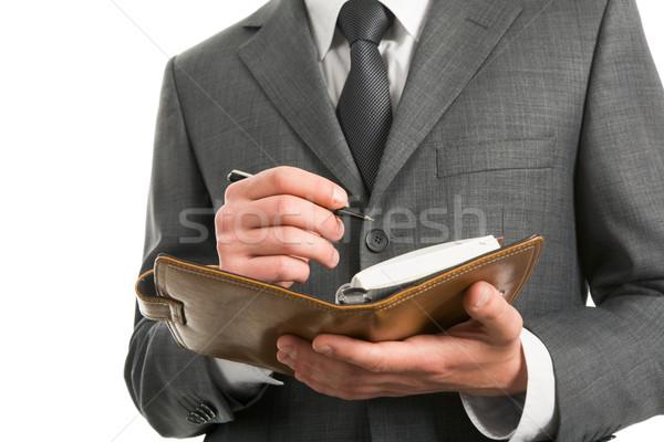 Merkt zakenman notepad Stockfoto © pressmaster