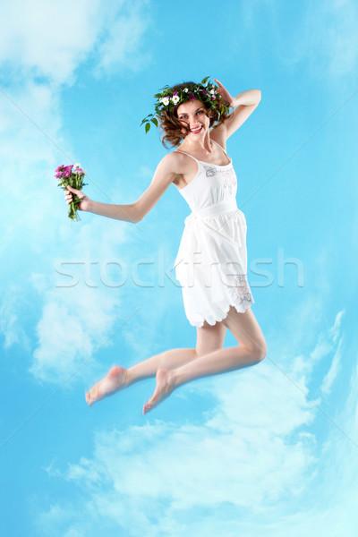 Woman jumping Stock photo © pressmaster
