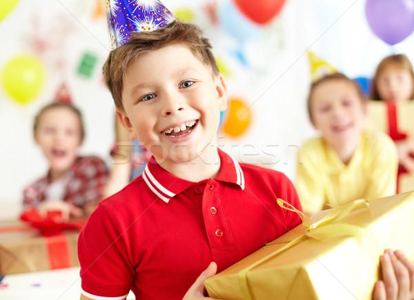 Heureux lad joyeux garçon regarder caméra Photo stock © pressmaster