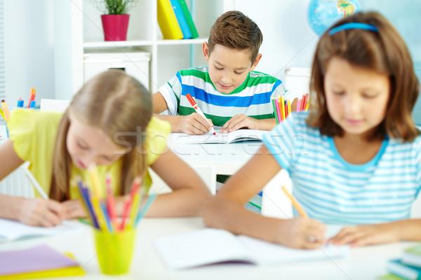 мальчика рисунок Cute школьник месте девушки Сток-фото © pressmaster