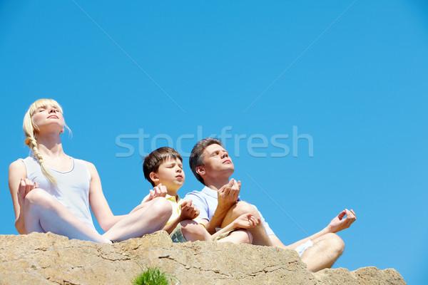 Harmonia foto três família meditando verão Foto stock © pressmaster