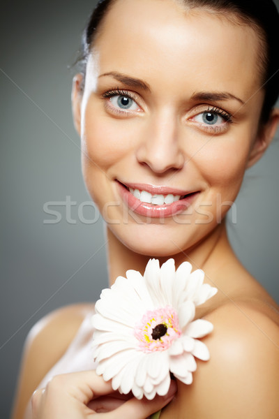 Girl with flower Stock photo © pressmaster