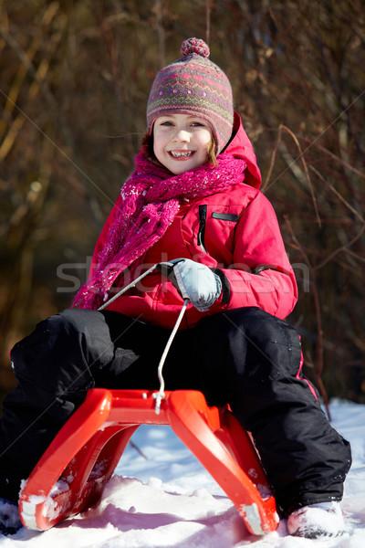 Girl on sledge Stock photo © pressmaster