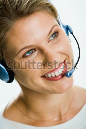 Bastante recepcionista jóvenes mujer de negocios auricular mirando Foto stock © pressmaster