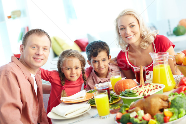 Family by festive table Stock photo © pressmaster