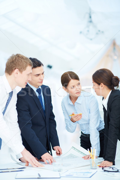 Discussing blueprint Stock photo © pressmaster