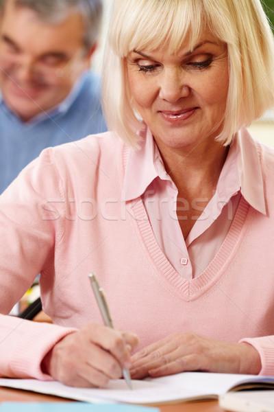 Woman writing  Stock photo © pressmaster