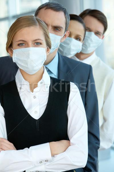 защита довольно женщины маске глядя камеры Сток-фото © pressmaster