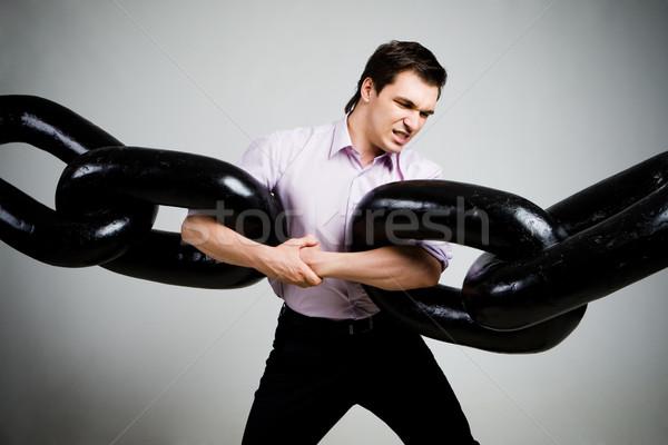 Portré feszült üzletember kettő hatalmas lánc Stock fotó © pressmaster