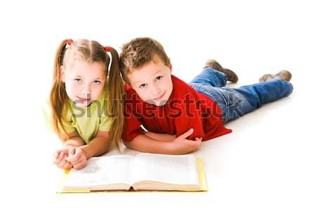 Reading encyclopaedia Stock photo © pressmaster