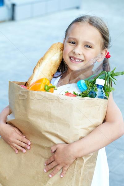 Kicsi vásárló portré kislány élelmiszer táska Stock fotó © pressmaster