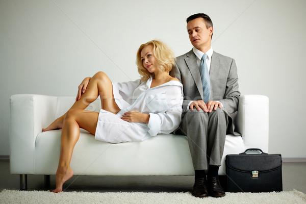 искушение фото человека костюм сидят диван Сток-фото © pressmaster