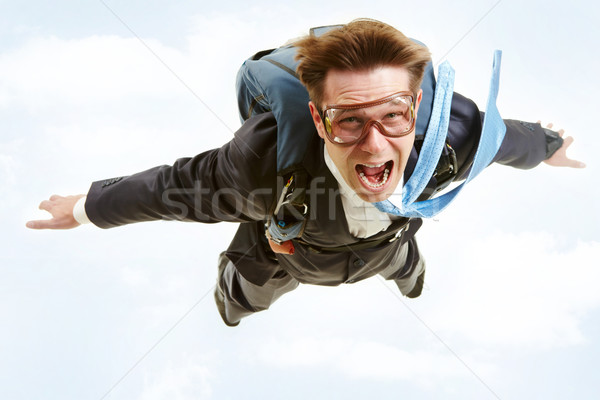 Battant homme image jeunes affaires parachute Photo stock © pressmaster