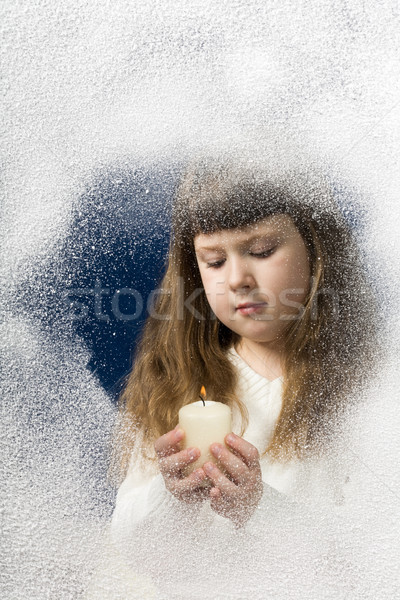 Girl with candle Stock photo © pressmaster