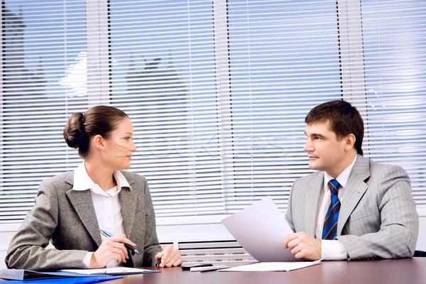 Tárgyalás fotó üzleti partnerek néz egyéb hivatalos Stock fotó © pressmaster