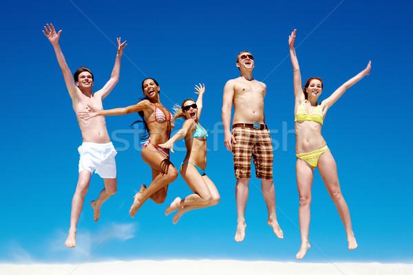 örömteli csapat barátok tart egyéb kezek Stock fotó © pressmaster