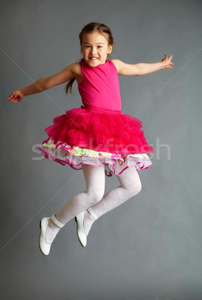Ragazza jumping ritratto cute bambina Foto d'archivio © pressmaster
