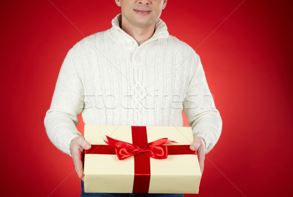 Man with Christmas gift Stock photo © pressmaster