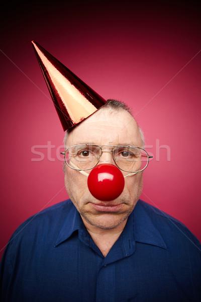 Mutsuz aptal portre adam kırmızı burun Stok fotoğraf © pressmaster
