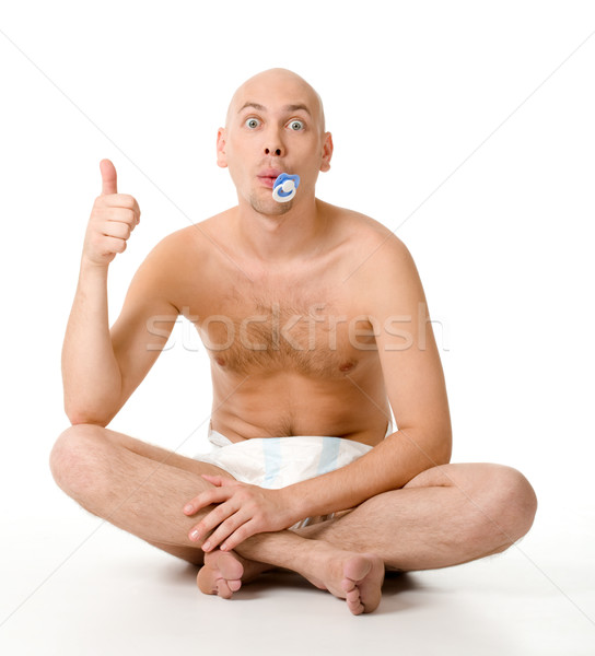 Stock photo: Baby man in diaper keeping his thumb up and looking into camera