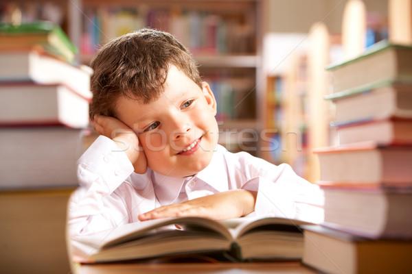 школьник портрет улыбаясь сидят таблице книгах Сток-фото © pressmaster