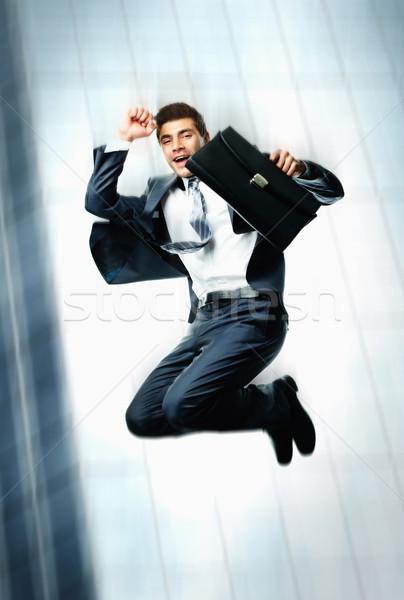 Dynamisch zakenman creatieve afbeelding blijde aktetas Stockfoto © pressmaster