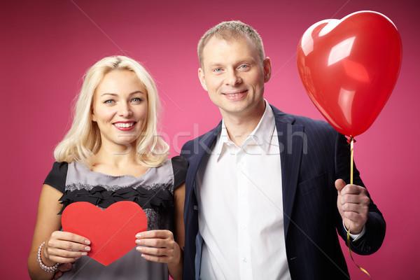 Szerelmi pár portré boldog piros papír Stock fotó © pressmaster