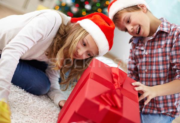 Taking a look inside giftbox Stock photo © pressmaster