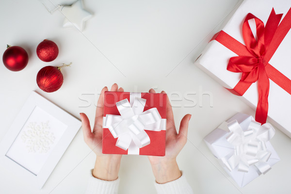 Christmas present on palms Stock photo © pressmaster