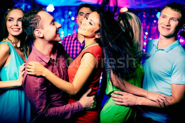 Boldog fiatal barátok tánc diszkó nő Stock fotó © pressmaster