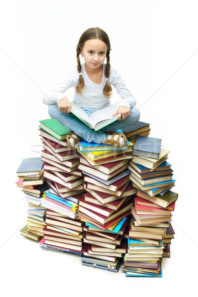 Stock photo: Girl on books