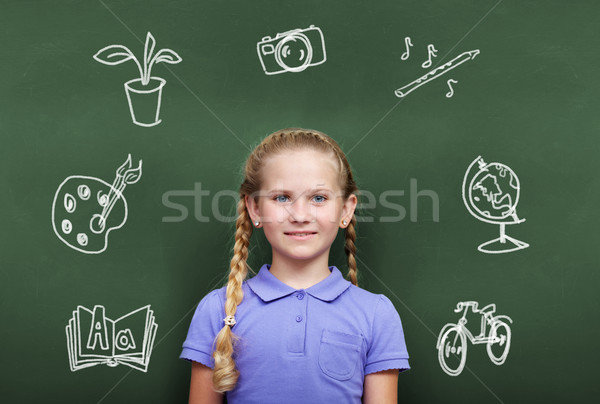 Stock photo: Girl by blackboard