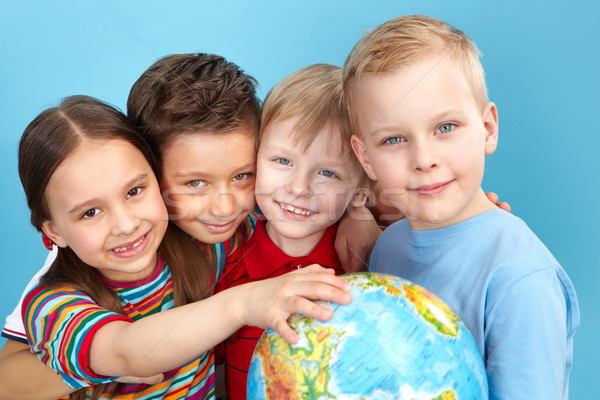 Cute kids with globe Stock photo © pressmaster