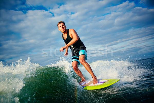 Extreme activiteit mannelijke paardrijden golven recreatie Stockfoto © pressmaster