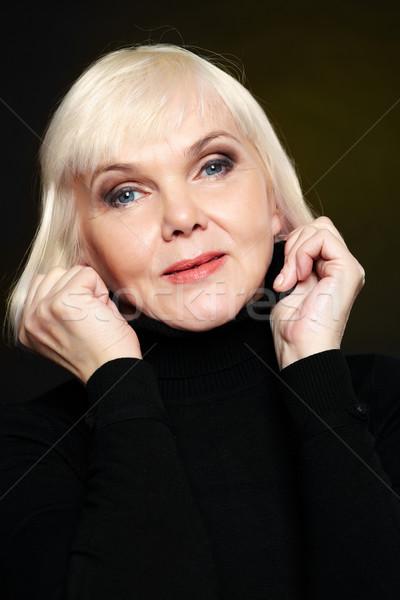 Blonde on black  Stock photo © pressmaster