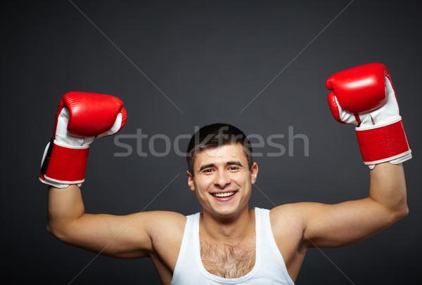 триумф портрет счастливым молодым человеком красный боксерские перчатки Сток-фото © pressmaster