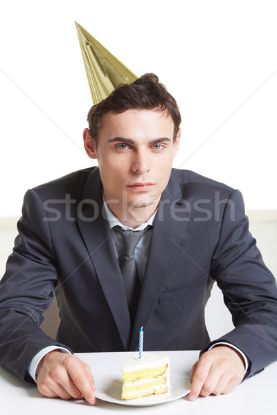 Unalmas születésnap portré fiatal üzletember sapka Stock fotó © pressmaster
