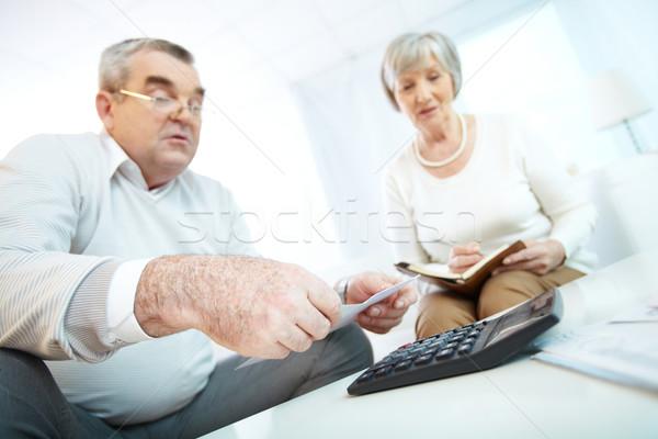 Planning budget afbeelding paar home calculator Stockfoto © pressmaster