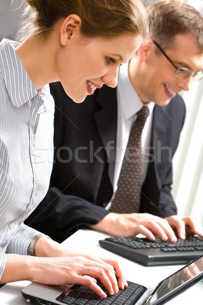 Bilgisayar çalışmak iş adamları yazarak bir şey Stok fotoğraf © pressmaster
